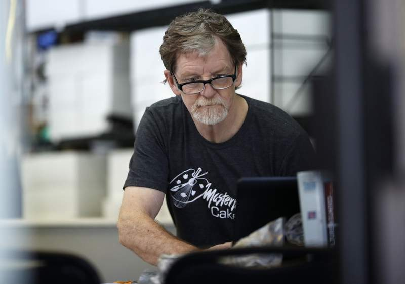FILE - In this Monday, June 4, 2018, file photograph, baker Jack Phillips, owner of Masterpiece Cakeshop, manages his shop in Lakewood, Colo. Baker, who refused to make a wedding cake for a gay couple in 2012 is being sued by a lawyer for declining to make a cake celebrating her gender transition. The U.S. Supreme Court ruled in 2018 the commission showed anti-religious bias when it sanctioned Phillips. The justices did not rule on the larger issue of whether businesses can invoke religious objections to refuse service to gays or lesbians. (AP Photo/David Zalubowski, File)