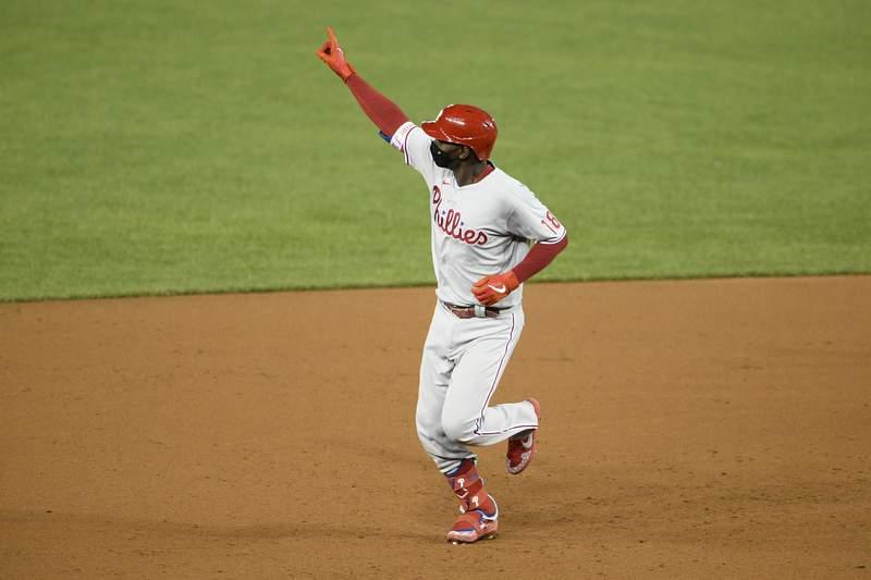 Philadelphia Phillies' Didi Gregorius celebrates his three-run home run during the ninth inning of the team's baseball game against the Washington Nationals, Wednesday, Sept. 23, 2020, in Washington. (AP Photo/Nick Wass)