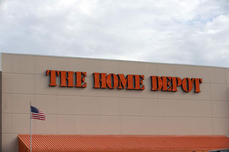 FILE - In this Aug. 27, 2019 file photo, the Home Depot logo is shown on a store in Bloomington, Minn.  (AP Photo/Jim Mone, File)
