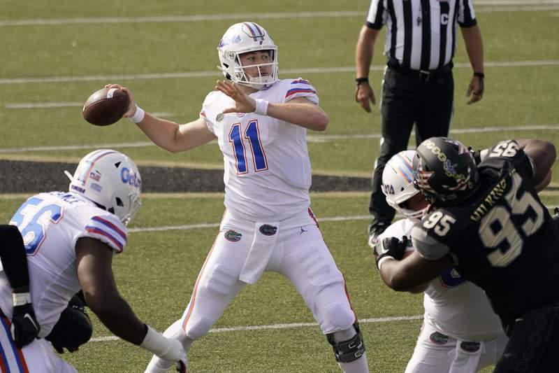 Florida quarterback Kyle Trask (11) passes against Vanderbilt in the first half of an NCAA college football game Saturday, Nov. 21, 2020, in Nashville, Tenn. (AP Photo/Mark Humphrey)