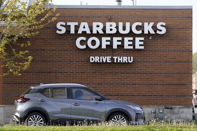 A customers exits the drive thru lane at a Starbucks coffee shop, Tuesday, April 27, 2021, in Des Moines, Iowa. After four straight quarters of sales declines, Starbucks returned to growth in the January-March period. (AP Photo/Charlie Neibergall)