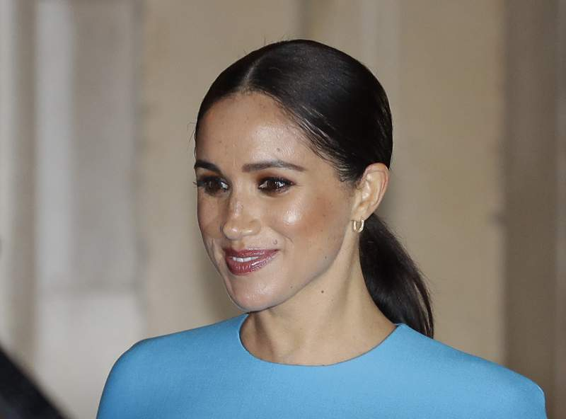 FILE - In this file photo dated Thursday, March 5, 2020,  Britain's Meghan, the Duchess of Sussex leaves after attending the annual Endeavour Fund Awards in London.  A British newspaper publisher on Tuesday March 2, 2021, is seeking permission to appeal against a judges ruling that it invaded the privacy of the Duchess of Sussex by publishing parts of a letter she wrote to her estranged father after her 2018 marriage to Prince Harry. (AP Photo/Kirsty Wigglesworth, FILE)