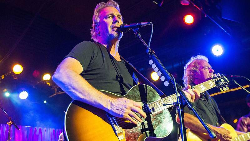 Kevin Costner on lead guitar singing and playing a show with his band, Modern West
