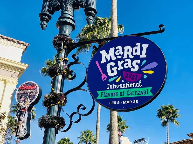 Universal Orlando Mardi Gras 2021 sign on Feb. 4, 2021