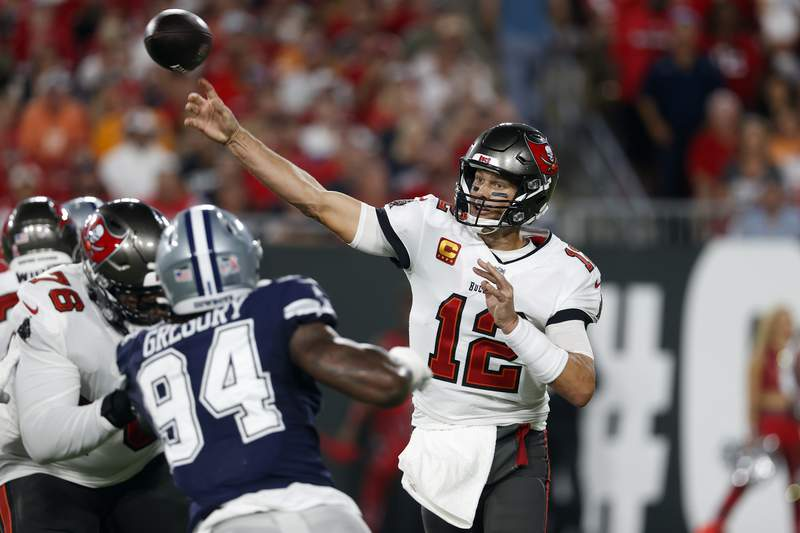 Tampa Bay Buccaneers quarterback Tom Brady (12) fires a pass against the Dallas Cowboys during the first half of an NFL football game Thursday, Sept. 9, 2021, in Tampa, Fla. (AP Photo/Scott Audette)