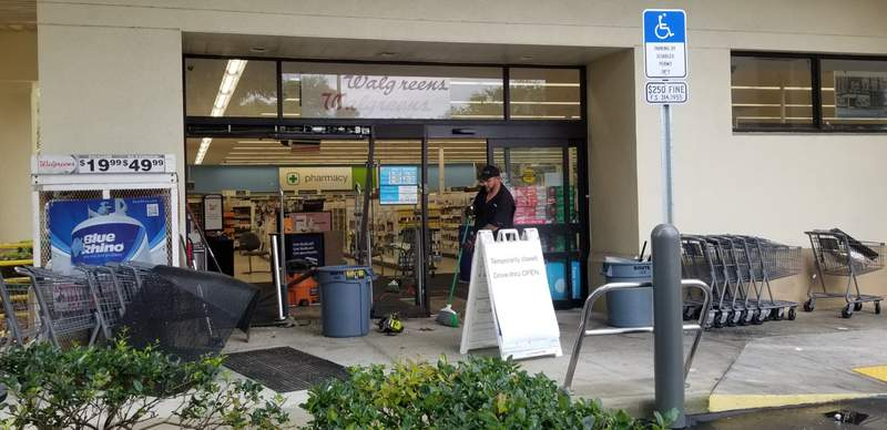 A car crashes into a Walgreens in Ormond Beach.,