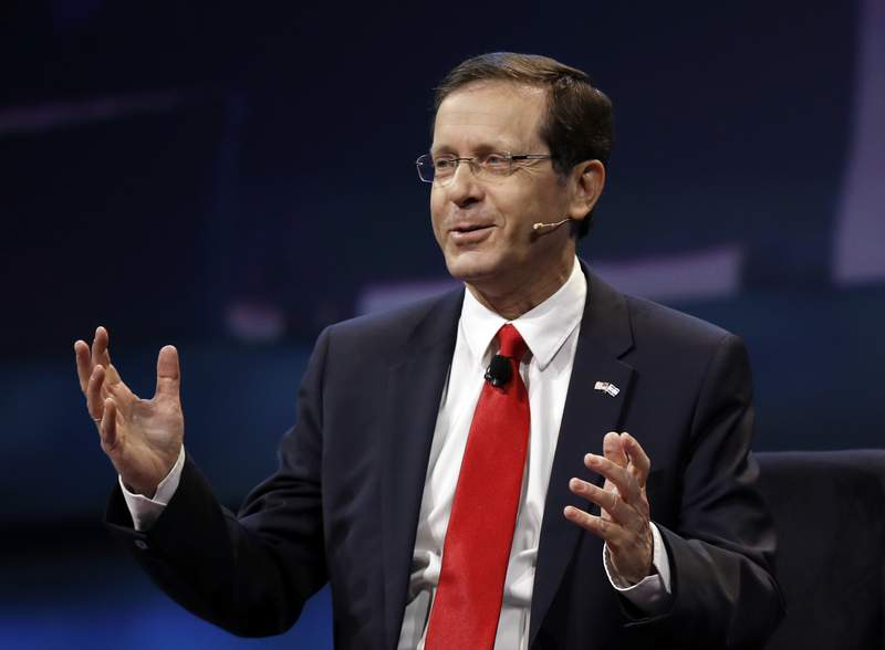 FILE - In this Monday, March 27, 2017, file photo, Isaac Herzog speaks at the AIPAC Policy Conference in Washington. The Israeli parliament on Wednesday, June 2, 2021, is set to choose the country's next president, a largely figurehead position that is meant to serve as the nation's moral compass and promote unity. Two candidates are running  Herzog, a veteran politician and scion of a prominent Israeli family, and Miriam Peretz, an educator who is seen as a down-to-earth outsider. (AP Photo/Manuel Balce Ceneta, File)