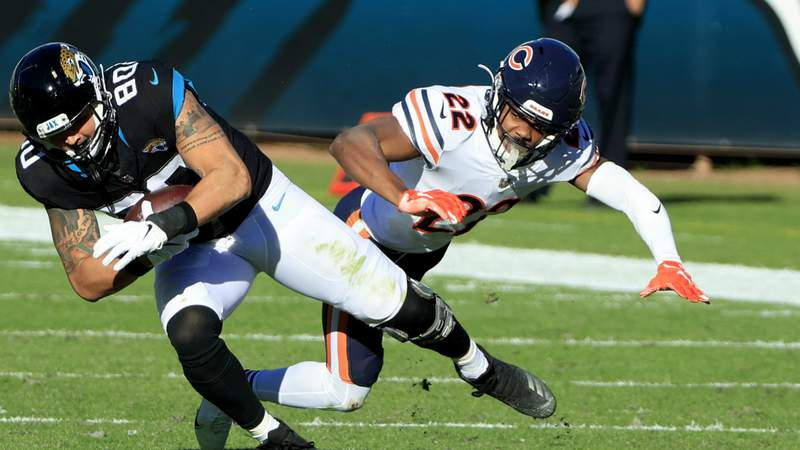 James O'Shaughnessy #80 of the Jacksonville Jaguars is tackled by Kindle Vildor #22 of the Chicago Bears at TIAA Bank Field on December 27, 2020 in Jacksonville, Florida. (Photo by Sam Greenwood)
