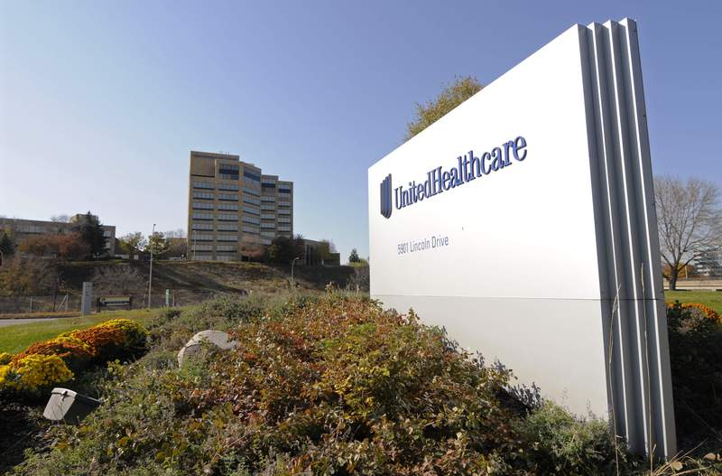 FILE - This Oct. 16, 2012, file photo, shows a portion of the UnitedHealth Group Inc.'s campus in Minnetonka, Minn. UnitedHealth profits jumped about 44% in the first quarter and the nation's largest health insurer boosted its outlook for the year.  The company said Thursday, April 15, 2021, that the performance of its Optum division was particularly strong. (AP Photo/Jim Mone, File)