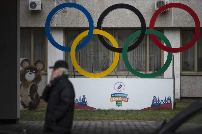 FILE - In this Nov. 28, 2019 file photo Olympic Rings and a model of Misha the Bear Cub, the mascot of the Moscow 1980 Olympic Games, left, are seen in the yard of Russian Olympic Committee building in Moscow, Russia. A U.S. government study concludes that Americans do not get their moneys worth out of the $2.7 million that Congress sent to the World Anti-Doping Agency this year. The report from the White House Office of National Drug Control Policy concludes that the U.S. is under-represented on WADAs key policymaking committees. It says WADA has not moved quickly or far enough to reform itself in the wake of the Russian doping scandal.  (AP Photo/Pavel Golovkin, file)