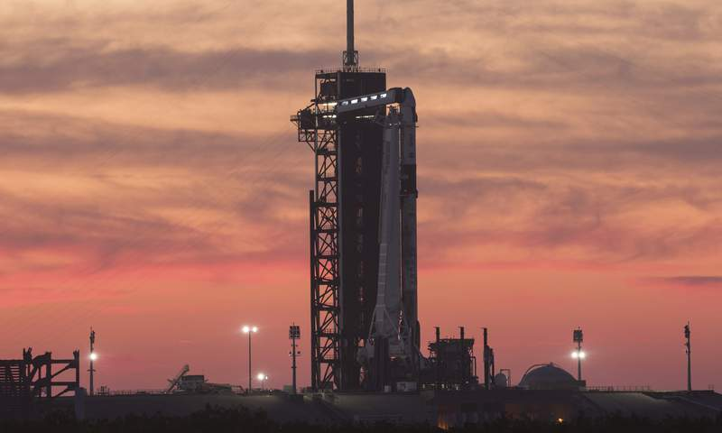 In this Wednesday, April 21, 2021 photo provided by NASA, a SpaceX Falcon 9 rocket with the company's Crew Dragon spacecraft onboard sits on the launch pad at Launch Complex 39A at NASA's Kennedy Space Center in Cape Canaveral, Fla., at sunset. NASA astronauts Shane Kimbrough and Megan McArthur, European Space Agency astronaut Thomas Pesquet, and Japan Aerospace Exploration Agency astronaut Akihiko Hoshide are scheduled for a Friday launch. (NASA/Joel Kowsky)