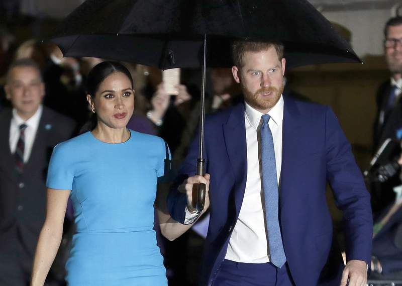 FILE - Prince Harry and Meghan, the Duke and Duchess of Sussex arrive at the annual Endeavour Fund Awards in London on March 5, 2020. A judge in London on Wednesday, July 29, 2020 is hearing the latest stage in the Duchess of Sussexs privacy-infringement lawsuit against a British newspaper, as Meghan tries to keep the names of five of her friends out of the public eye. The former Meghan Markle is suing the publisher of the Mail on Sunday at Britains High Court over five articles that published portions of a handwritten letter she wrote to her estranged father, Thomas Markle. (AP Photo/Kirsty Wigglesworth, File)