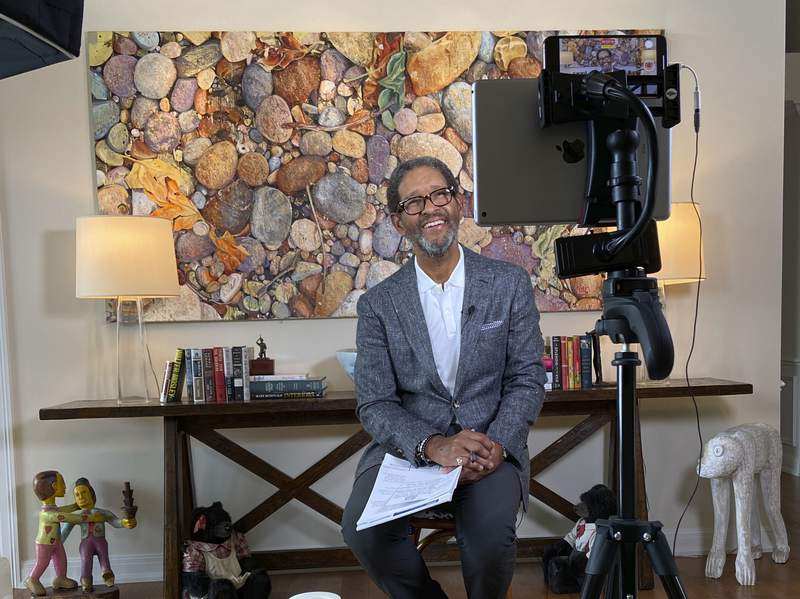 """This image released by HBO Sports shows Bryant Gumbel hosting """"Real Sports with Bryant Gumbel"""" from his makeshift studio in Florida. The series returns on April 28. (HBO Sports via AP)"""