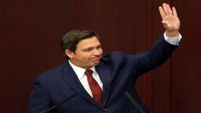 Florida Gov. Ron DeSantis waves to the gallery as he makes his state of the state speech on the first day of legislative session Tuesday, March 5, 2019, in Tallahassee, Fla. (AP Photo/Steve Cannon)
