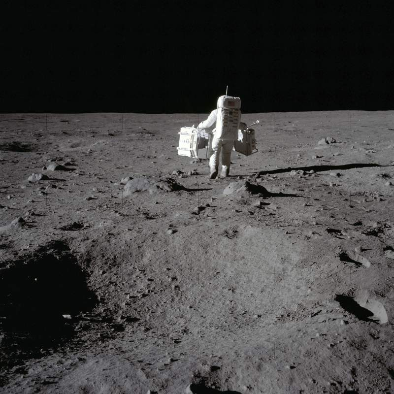 In this July 20, 1969 photo made available by NASA, lunar module pilot Buzz Aldrin carries a seismic experiments package in his left hand and the Laser Ranging Retroreflector to the deployment area on the surface of the moon at Tranquility Base. On Tuesday, Oct. 13, 2020, NASA released a set of guidelines for its Artemis moon-landing program, based on the 1967 Outer Space Treaty and other agreements - No fighting and littering. And no trespassing at historic lunar landmarks like Apollo 11s Tranquility Base.  (Neil Armstrong/NASA via AP)
