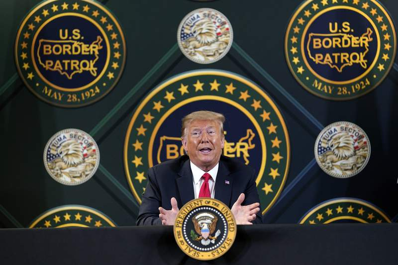 FILE - In this June 23, 2020, file photo President Donald Trump participates in a border security briefing at United States Border Patrol Yuma Station in Yuma, Ariz. President Donald Trump is promising new executive action on immigration as he returns to the defining issue of his administration. (AP Photo/Evan Vucci, File)