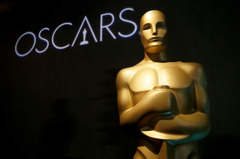 FILE - In this Feb. 4, 2019, file photo, an Oscar statue appears at the 91st Academy Awards Nominees Luncheon in Beverly Hills, Calif. In an historic move, the Oscars are raising the inclusion bar for best picture nominees starting in 2024. The Academy of Motion Picture Arts and Sciences on Tuesday, Sept. 8, 2020, laid out sweeping eligibility reforms to the best picture category intended to encourage diversity and equitable representation on and off screen beginning with the 96th Academy Awards. (Photo by Danny Moloshok/Invision/AP, File)