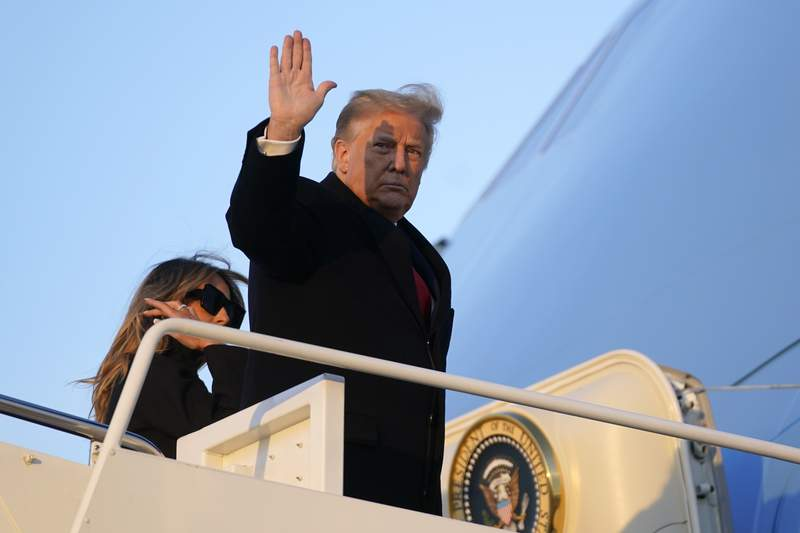 President Donald Trump waves as he boards Air Force One at Andrews Air Force Base, Md., Wednesday, Dec. 23, 2020. Trump is traveling to his Mar-a-Lago resort in Palm Beach, Fla. (AP Photo/Patrick Semansky)