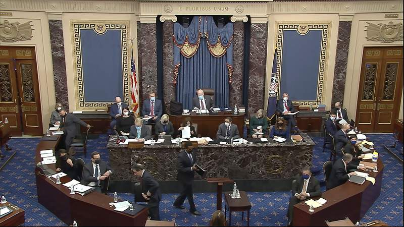 In this image from video, House impeachment manager Rep. Joe Neguse, D-Colo., prepares to speak during the second impeachment trial of former President Donald Trump in the Senate at the U.S. Capitol in Washington, Tuesday, Feb. 9, 2021. (Senate Television via AP)