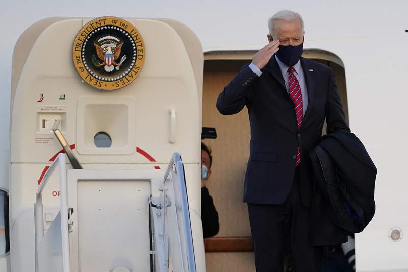 President Joe Biden boards Air Force One at Andrews Air Force Base, Md., for a weekend trip to Wilmington, Del., Friday, Feb. 5, 2021. (AP Photo/Manuel Balce Ceneta)