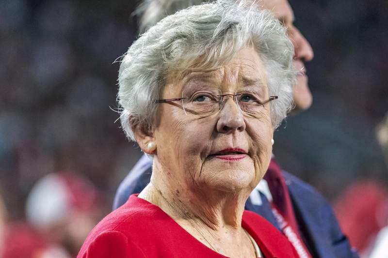 FILE - In this Saturday, Oct. 26, 2019, file photo, Alabama Gov. Kay Ivey visits for homecoming festivities during the first half of an NCAA college football game between Alabama and Arkansas, in Tuscaloosa, Ala. Alabama Gov. Kay Ivey said she plans to sign agreements Monday, Feb. 1, 2021 for two privately built prisons, despite lawmakers' complaints about the pricetag and lack of public transparency and warnings from advocacy groups that such prisons won't address chronic violence and severe staffing woes.(AP Photo/Vasha Hunt, File)