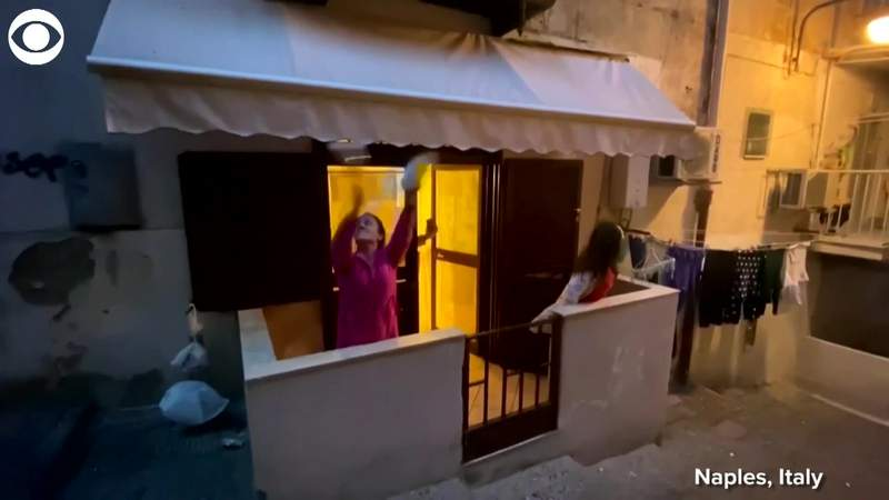 Italians keep spirits up by singing from balconies during coronavirus outbreak