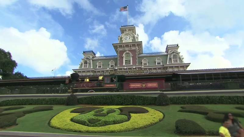 A steam train from The Walt Disney World Railroad pulls into the station at the entrance to the Magic Kingdom and Main Street, USA