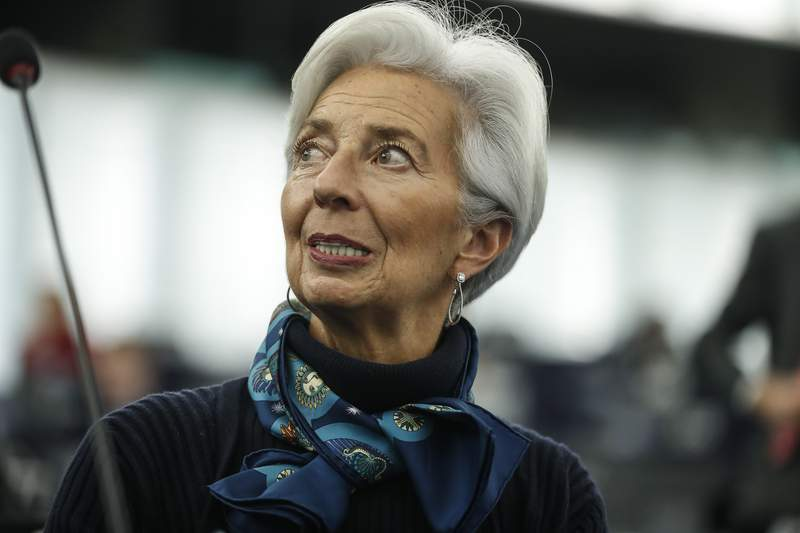 FILE - In this Tuesday Feb. 11, 2020 file photo, Christine Lagarde president of the ECB looks up prior to deliver her speech before the European Parliament's economic and monetary affairs committee at the European Parliament in Strasbourg, France.  Lagarde says on Wednesday, Nov. 11,  the recovery could be bumpy until vaccination becomes widespread. That warning came in a speech at an online ECB conference. While recent news of vaccine tests is promising, Lagarde says the economy could face recurring cycles of growth and restrictions until enough people can be vaccinated. (AP Photo/Jean-Franois Badias, File)