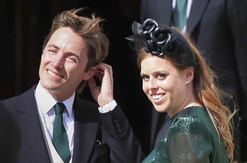 FILE - In this Aug. 31, 2019 file photo, Princess Beatrice and her husband Edoardo Mapelli Mozzi attend the wedding of Ellie Goulding and Caspar Jopling, in York, England. Princess Beatrice and her husband Edoardo Mapelli Mozzi announced the birth of a daughter, Buckingham Palace said Monday, Sept. 20, 2021. The baby, who was born on Saturday at London's Chelsea and Westminster Hospital, weighed 6 pounds and 2 ounces (2.78 kilos). Her name was not immediately revealed. (Peter Byrne/PA via AP, File)