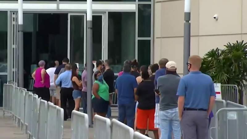 Dozens of pastors march to Amway Center to vote early