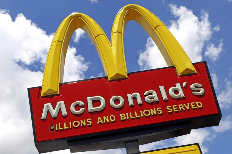 FILE - This June 25, 2019 file photo shows a McDonald's sign outside the restaurant in Pittsburgh. More than 50 Black former McDonalds franchise owners are suing the burger chain for discrimination. In a federal lawsuit filed Tuesday, Sept. 1 in Chicago, the 52 plaintiffs say McDonald's steered them to less-profitable restaurants and didnt give them the same support and opportunities given white franchisees. AP Photo/Gene J. Puskar, File)