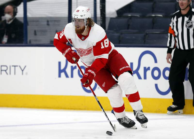FILE - In this May 8, 2021, file photo, Detroit Red Wings defenseman Marc Staal controls the puck during an NHL hockey game against the Columbus Blue Jackets in Columbus, Ohio. Staal is staying put in Detroit, while the Vancouver Canucks placed Jake Virtanen on waivers on Sunday, July 25, 2021, for the purpose of buying out the final year of the under-performing forwards contract. (AP Photo/Paul Vernon, File)