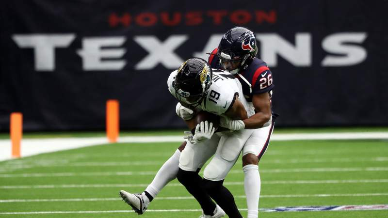 Collin Johnson #19 of the Jacksonville Jaguars runs the ball against Vernon Hargreaves III #26 of the Houston Texans in the third quarter at NRG Stadium on October 11, 2020 in Houston, Texas. (Photo by Ronald Martinez)