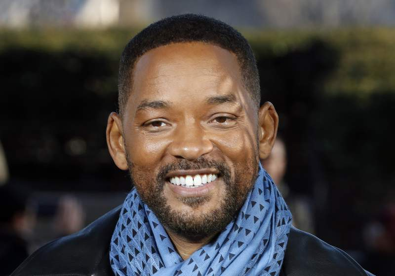 """FILE - In this Monday, Jan. 6, 2020, file photo, U.S actor Will Smith poses for photographers during the photo call of """"Bad Boys for Life,"""" in Paris. Smith says he was humbled and honored after rapper Joyner Lucas released a tribute song honoring his career work. Lucas released the music video for his track Will, on Monday, March 23, 2020. (AP Photo/Thibault Camus, File)"""