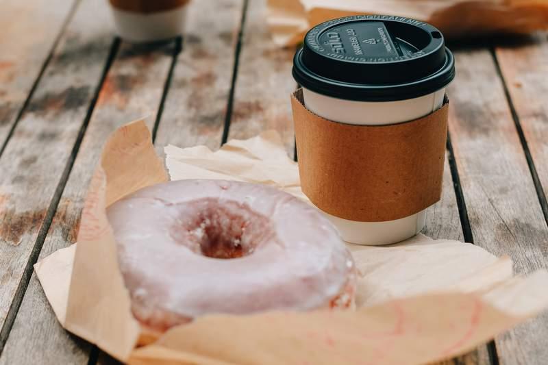 Glazed doughnut and coffee.