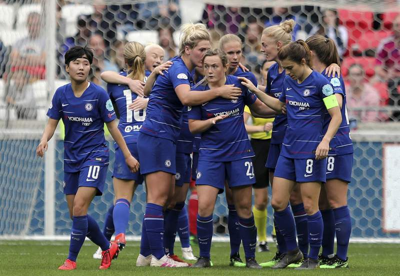 FILE - In this file photo dated Sunday, April 21, 2019, Chelsea's Erin Cuthbert, centre, and teammates celebrate scoring against Lyon during their Women's Champions League soccer match in Decines, France. The English Football Associations board have decided to determine the final standings on a points-per-game basis, Friday June 5, 2020, naming Chelsea as Womens Super League champions after the season was stopped because of the coronavirus pandemic. (AP Photo/Laurent Cipriani, FILE)