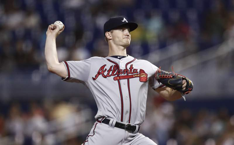 File - In this Aug. 10, 2019 file photo, Atlanta Braves starting pitcher Mike Soroka (40) delivers during the first inning of a baseball game against the Miami Marlins in Miami.  Soroka is facing season-ending surgery after again tearing his right Achilles tendon. The Braves said Saturday, June 26, 2021, Soroka suffered the new tear on Thursday while walking to the clubhouse at Truist Park. Soroka now faces his third surgery on the Achilles. (AP Photo/Brynn Anderson. File)