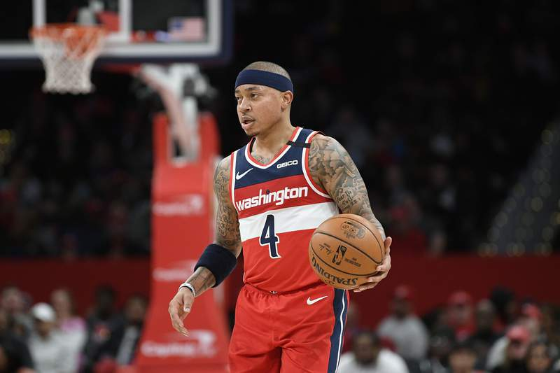 FILE - Washington Wizards guard Isaiah Thomas (4) dribbles the ball during the first half of an NBA basketball game against the Brooklyn Nets in Washington, in this Saturday, Feb. 1, 2020, file photo. USA Basketball has finalized the 14-player roster for the final round of AmeriCup qualifying later this month, a group led by NBA All-Stars Joe Johnson and Isaiah Thomas. (AP Photo/Nick Wass, File)
