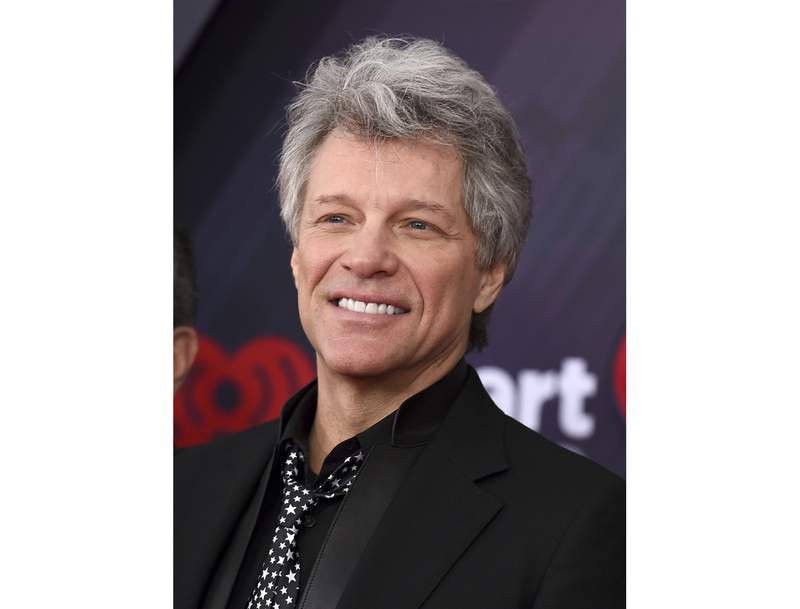 FILE - This March 11, 2018 file photo shows Jon Bon Jovi at the iHeartRadio Music Awards in Inglewood, Calif. A Florida kindergarten teacher took his virtual classroom to new levels on Monday when rock icon Jon Bon Jovi popped in on a writing lesson about life in the coronavirus quarantine. Last month, the 80s rocker released an incomplete version of Do What You Can, a ballad about the nations battle to contain the virus. He asked fans to submit verses to help complete it. Teacher Michael Bonick sent some of his students' writings about quarantine and Bon Jovi agreed to talk to the class.  (Photo by Jordan Strauss/Invision/AP, File)