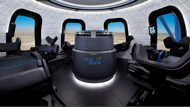 Blue Origin's crew capsule cabin with large windows and large seats.