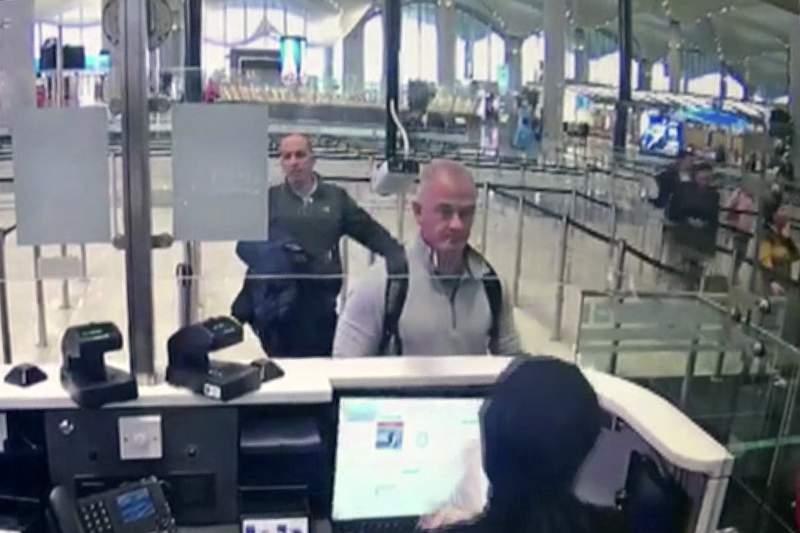 FILEThis Dec. 30, 2019 image from security camera video shows Michael L. Taylor, center, and George-Antoine Zayek at passport control at Istanbul Airport in Turkey. A federal judge has ruled that the Taylor and his son, accused of smuggling former Nissan Motor Co. Chairman Carlos Ghosn out of Japan while he was awaiting trial on financial misconduct charges, can be extradited. (DHA via AP)