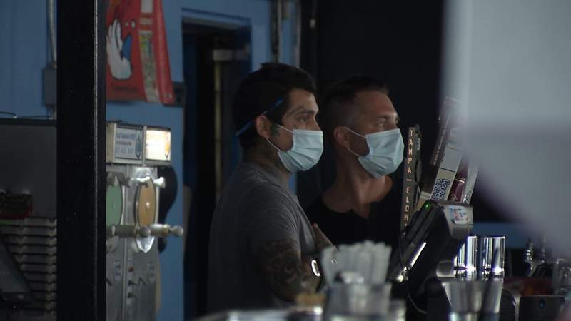 Employees at The Hammered Lamb wear masks during the coronavirus pandemic.