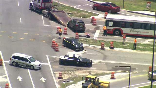 Two people, including a child, were injured in a crash involving a Disney bus on July 11, 2019. (Image: Sky 6)