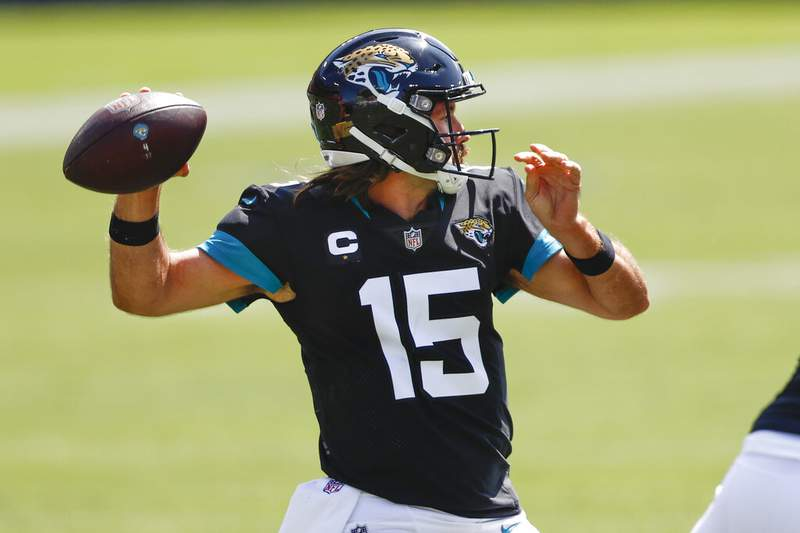Jacksonville Jaguars quarterback Gardner Minshew (15) passes against the Tennessee Titans in the first half of an NFL football game Sunday, Sept. 20, 2020, in Nashville, Tenn. (AP Photo/Wade Payne)