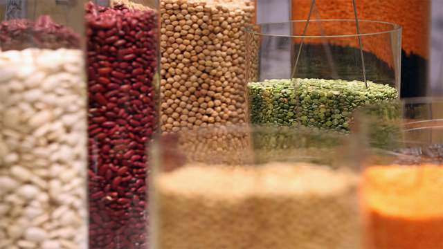 Organic pulses, including lentils and beans, lie in glass cylinders on display at the 2013 Gruene Woche agricultural trade fair on January 18, 2013 in Berlin, Germany. (Photo by Sean Gallup/Getty Images)