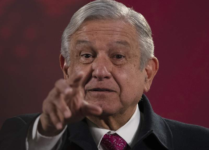 "Mexican President Andres Manuel Lopez Obrador gives his regularly scheduled morning press conference known as ""La Maanera"" at the National Palace in Mexico City, Friday, Dec. 18, 2020. Las Maaneras are a platform for the president to relay information he says the media ignore or misrepresent. (AP Photo/Marco Ugarte)"