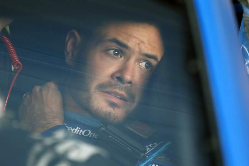 FILE - In this Oct. 18, 2019, file photo, Kyle Larson sits in his car before the final practice for a NASCAR Cup Series auto race at Kansas Speedway in Kansas City, Kan. Kyle Larson has been working behind the scenes to educate himself on racial issues since his firing from NASCAR for using a slur.  (AP Photo/Colin E. Braley, File)