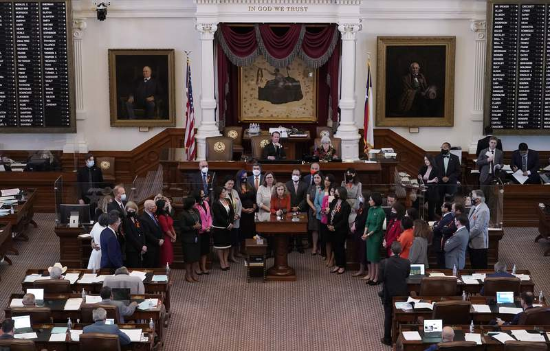 FILE - In this May 5, 2021, file photo, Texas state Rep. Donna Howard, D-Austin, center at lectern, stands with fellow lawmakers in the House Chamber in Austin, Texas, as she opposes a bill introduced that would ban abortions as early as six weeks and allow private citizens to enforce it through civil lawsuits, under a measure given preliminary approval by the Republican-dominated House. A Texas law banning most abortions in the state took effect at midnight on Sept. 1 but the Supreme Court has yet to act on an emergency appeal to put the law on hold. If allowed to remain in force, the law would be the most dramatic restriction on abortion rights in the United States since the high courts landmark Roe v. Wade decision legalized abortion across the country in 1973. (AP Photo/Eric Gay, File)