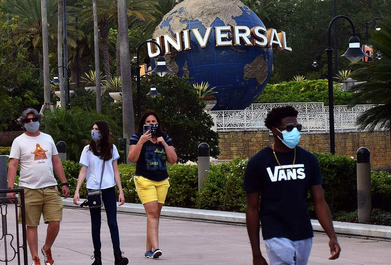 ORLANDO, UNITED STATES - MAY 14, 2020: Guests wearing face masks visit the Universal Orlando's CityWalk as sections of the entertainment and retail district opened today for limited hours for the first time since Universal Orlando closed on March 15, 2020 due to the coronavirus pandemic. In addition to face coverings, temperature checks are also being required. Universal's theme parks will remain closed until at least May 31.- PHOTOGRAPH BY Paul Hennessy / Echoes Wire/ Barcroft Studios / Future Publishing (Photo credit should read Paul Hennessy / Echoes Wire/Barcroft Media via Getty Images)