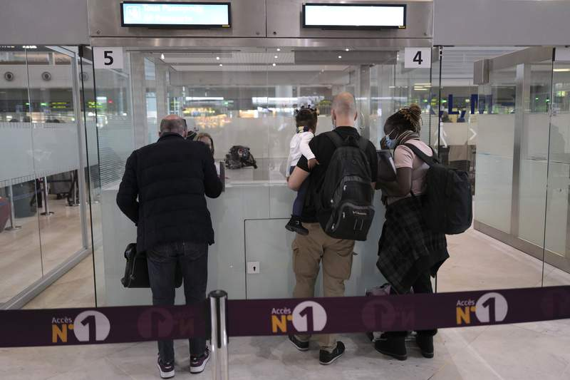 FILE - In this Feb. 1, 2021 file photo, passengers are checked by French police officers prior to boarding their plane at Paris Charles de Gaulle Airport in Roissy, north of Paris. France is imposing entry restrictions on travelers from four countries  Argentina, Chile, South Africa and Brazil  in hopes of keeping out especially contagious coronavirus variants, the government has announced. (AP Photo/Francois Mori, File)